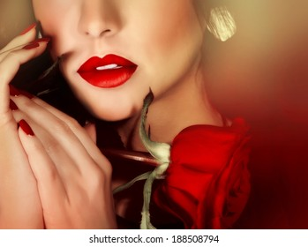 Closeup portrait of sexy gorgeous woman with red lipstick and red rose, half face, luxury beauty salon, seduction concept