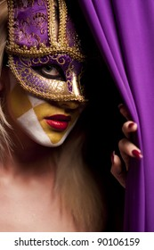 close-up portrait of sexy woman in violet party mask for desire concept