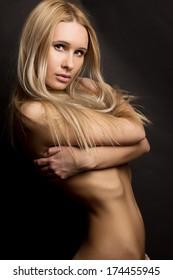 Closeup portrait of a sexy young female fashion model posing