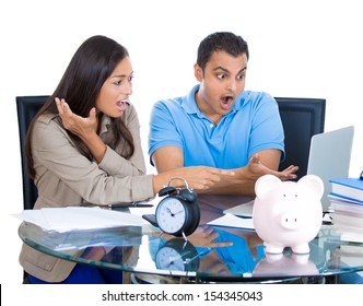 Closeup portrait of shocked attractive man and woman looking at bill on laptop, isolated on white background