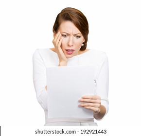 Closeup portrait shocked, funny looking young woman, disgusted at monthly statement, test, application, results isolated white background. Negative human emotion, facial expression, feeling. Bad news