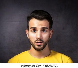 Close-up portrait of a shocked man