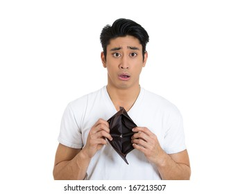 Closeup portrait of shocked, surprised, speechless man, student, worker, employee, holding empty wallet isolated on white background. Bankruptcy, financial difficulties concept. Human face expression