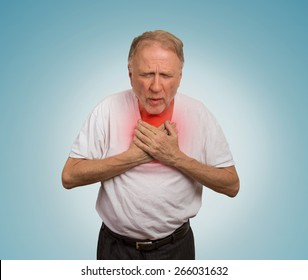 Closeup portrait sick old man, elderly guy, having severe infection, chest pain, looking miserable unwell, trying to catch his breath isolated on light blue background. Geriatric health care concept