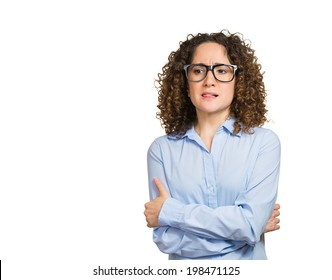 Closeup portrait skeptical, upset young woman looking suspicious, disgust on face, mixed disapproval, judgement isolated white background. Negative human emotion, facial expression, feeling, attitude