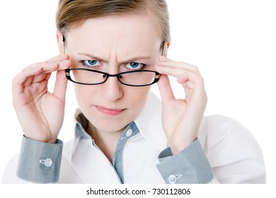 closeup portrait of skeptical young female wearing glasses trying to work out something mentally isolated on white looking at camera