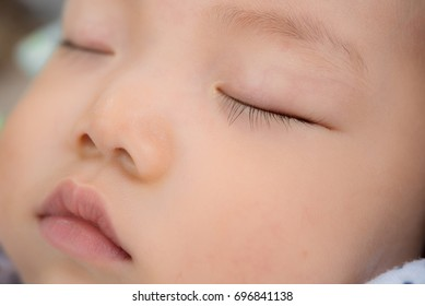 close-up portrait of a sleeping asiab baby outdoor