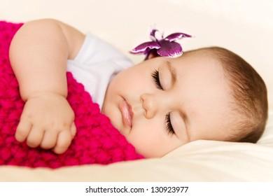 Closeup portrait of a sleeping baby girl