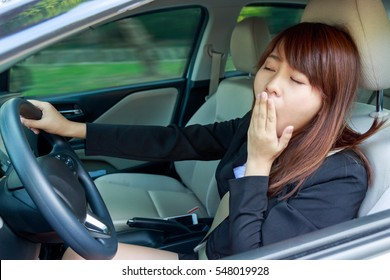 Closeup portrait sleepy, tired, close eyes young woman driving her car after long hour trip, Sleep deprivation, accident concept