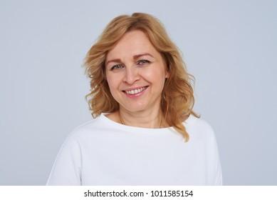 Close-up portrait of smiley mature woman