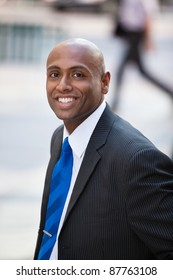 Close-up portrait of a smiling African American business man