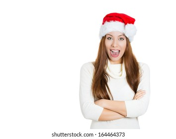 Closeup portrait of smiling beautiful young Christmas woman, wearing red Santa hat, sweater, arms folded, isolated on white background, copy space to left. Positive human emotions, facial expressions