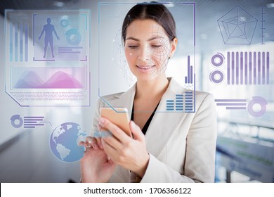 Closeup portrait of smiling beautiful young business woman wearing jacket and using smartphone in office hall. Communication concept with face scan virtual infographics