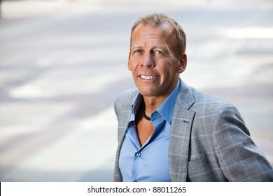 Close-up portrait of smiling businessman