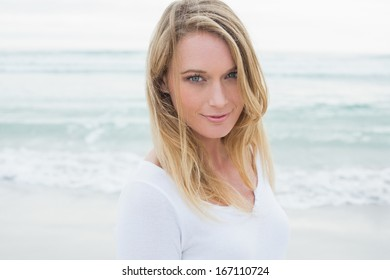 Close-up portrait of a smiling casual young woman at the beach