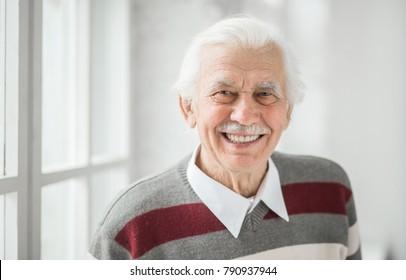 close-up portrait of a smiling caucasian elderly man