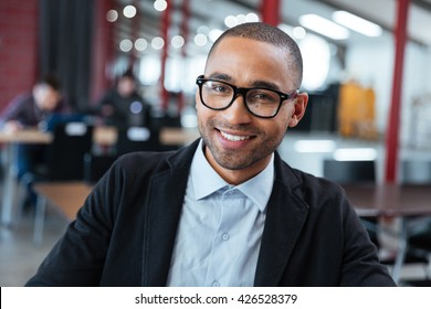 Close-up portrait of smiling cheerful businessman
