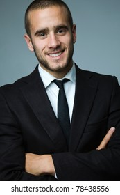 Close-up portrait of a smiling handsome young business man