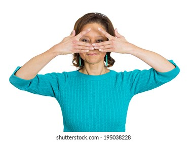 Closeup portrait smiling, happy senior, elderly woman trying to see, looking through her fingers placed in front of face, isolated white background. Human facial expressions, emotions, life perception