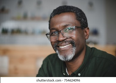 close-up portrait of smiling mature african american man in bar