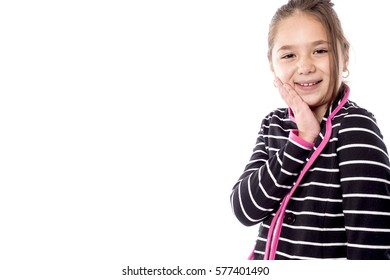 Closeup portrait of a smiling pretty school girl isolated over white background