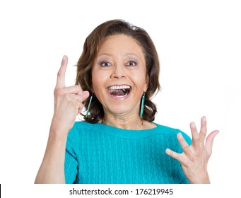 Closeup portrait of smiling pretty senior mature woman pointing with index finger up aha having the right answer, isolated on white background. Positive emotion facial expression feeling, attitude