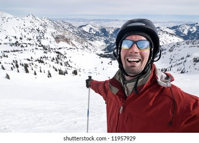 Close-up portrait of a smiling skier stretching his arms