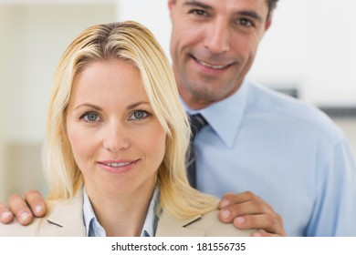 Closeup portrait of a smiling woman and man in the kitchen at home