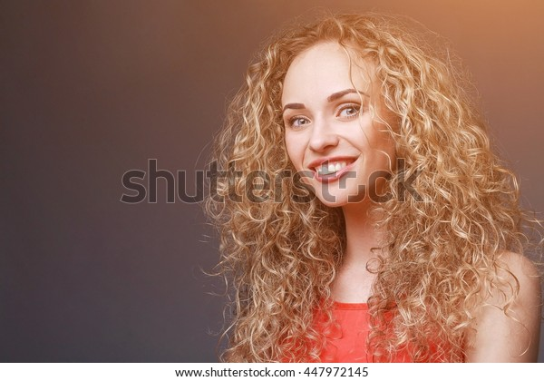 Closeup portrait of smiling woman in red shirt