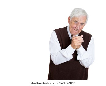 Closeup portrait of a sneaky, evil, sly, scheming senior old guy, trying to plot something and screw someone, isolated on white background space to left. Negative human emotions and facial expressions