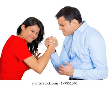 Closeup portrait of strained man arm wrestling with pressured woman at office job work, isolated on white background. Negative emotion facial expression feelings. Social justice equality