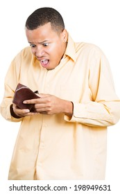 Closeup portrait, stressed, upset, sad, unhappy young man standing with, looking into empty wallet, isolated white background. Financial difficulties, bad economy concept. Negative human emotions