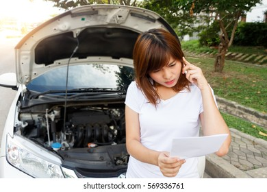 Closeup portrait, Stressed woman calling for help or insurance agent on cell phone with mobile phone on road- car breakdown