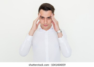 Closeup portrait of stressed young handsome man looking at camera, touching temples and thinking. Contemplation concept. Isolated front view on white background.