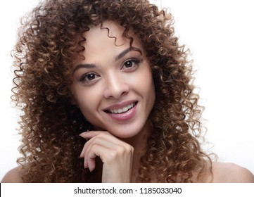 Close-up portrait of a stylish young woman with wavy hair