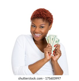 Closeup portrait of super happy excited successful young business woman holding money dollar bills in hand, isolated on white background. Positive emotion facial expression feeling. Financial reward