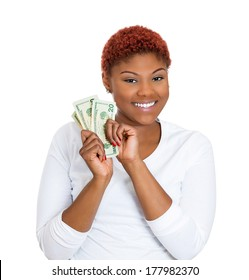 Closeup portrait of super happy excited successful young business woman holding money dollar bills in hand, isolated on white background. Positive emotions, facial expression feeling. Financial reward