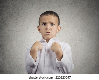Closeup portrait surprised child boy getting unexpected attention from people asking you talking to, mean me? pointing fingers at himself isolated grey wall background. Human facial expression emotion