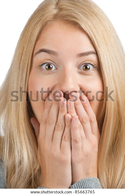 Close-up portrait of surprised excited woman covering her mouth by the hands, over white background
