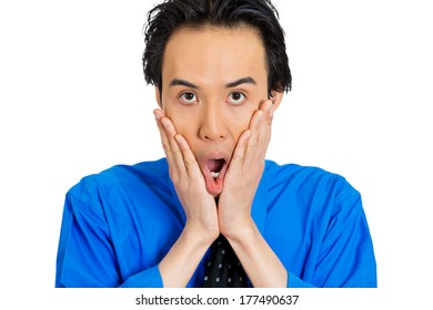 Closeup portrait of surprised, shocked, stunned young man, worker, employee, in full disbelief hands on face, isolated white background. Human facial expressions, emotions, reaction, perception