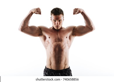 Close-up portrait of sweaty strong sports man showing his biceps, looking at camera, isolated on white background