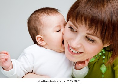 Closeup portrait of a sweet baby and mother