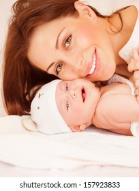 Closeup portrait of sweet newborn baby with pretty mom, healthy childhood, young family, happy motherhood, tenderness and love concept