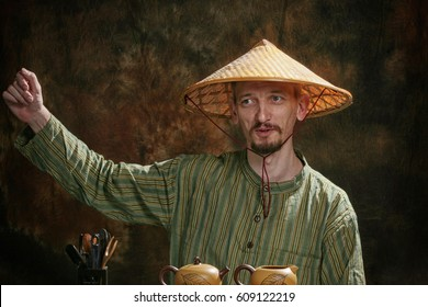 closeup portrait of a tea master in the studio against a dark background