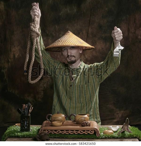 closeup portrait of a tea master in the studio against a dark background