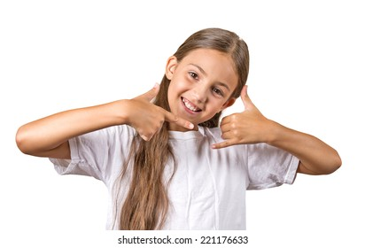 Closeup portrait  teenager girl making call me gesture sign with hand shaped like phone, isolated white background. Positive human emotions, face expressions, body language, communication
