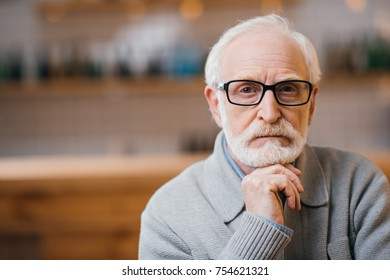close-up portrait of thoughtful senior man looking at camera