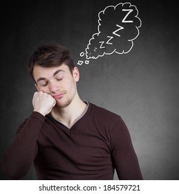Closeup portrait tired, young man who just fell asleep on his hand, eyes closed, isolated gray black with thought bubble containing zzzzz, background. Human emotion, facial expressions