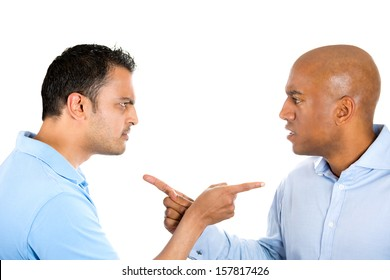 Closeup portrait of two angry guys pointing fingers at each other and blaming for problems, isolated on white background. Interpersonal conflict resolution. Human emotions and facial expressions.