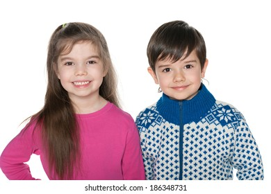 A closeup portrait of two cheerful fashion children on the white background